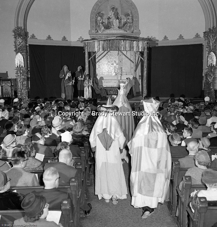 Pittsburgh PA: View of the Christmas play; the birth of baby Jesus, at the First Luthern Church on Grant Street in Pittsburgh.  Members of the congregation donned period clothing the recreate Christmas night 1958 years earlier.  The 3 wise men approaching the stable with baby Jesus and Mary and Joseph