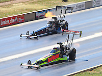 Jul 24, 2016; Morrison, CO, USA; NHRA top fuel driver J.R. Todd (near) races alongside Scott Palmer during the Mile High Nationals at Bandimere Speedway. Mandatory Credit: Mark J. Rebilas-USA TODAY Sports