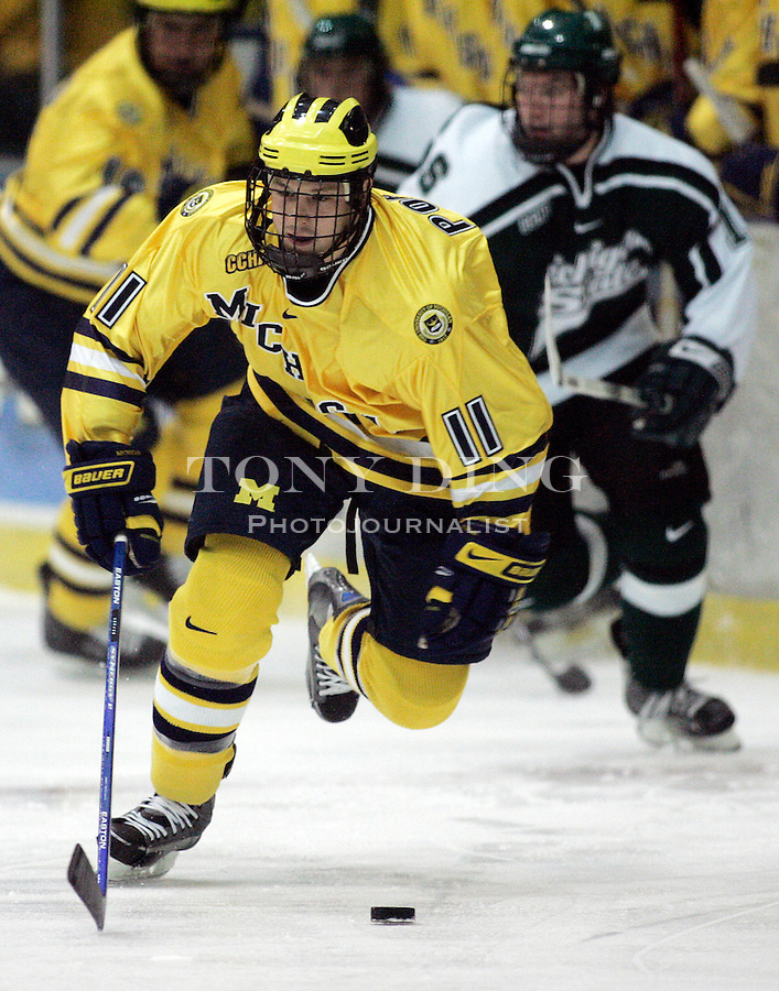 4 November 2006: Michigan junior Kevin Porter (11) dribbles the puck up the rink during a CCHA conference ice hockey game between Michigan and in-state rival Michigan State, at Yost Ice Arena in Ann Arbor, MI. Michigan won the game 6-2.