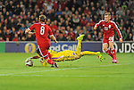 UEFA European Championship at Cardiff City Stadium - Wales v Cyprus : <br /> Cyprus goalkeeper Tasos Kissas gets to the abll as Andy King and George Williams of Wales threaten.