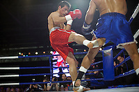 Moscow, Russia, 05/06/2010..Batu Khasikov kicks Ricardo Fernandes in a world championship kickboxing bout during the new Fight Nights boxing tournament.
