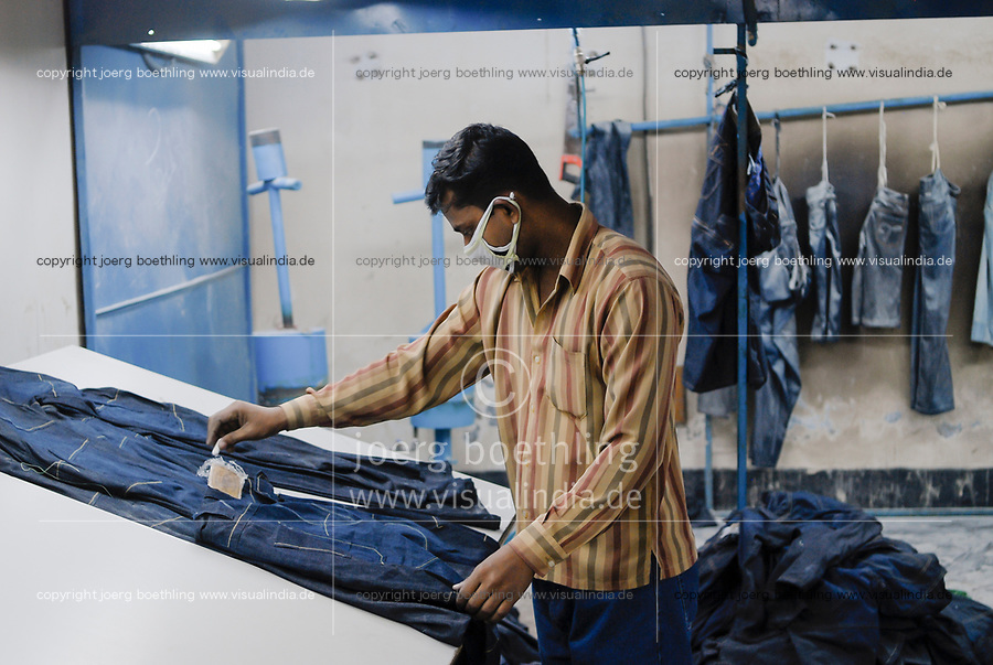 BANGLADESH , textile industry in Dhaka , Beximco textile factory produce Jeans for export for western discounter, department for extra styling like raze and sand with abrasive paper / BANGLADESCH, Dhaka, Beximco Textilfabrik produziert Jeans fuer den Export fuer westliche Modeketten und Textildiscounter, Abteilung fuer extra styling, schleifen mit Sandpapier