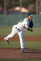 AZL Athletics starting pitcher Angello Infante (49) follows through on his delivery during an Arizona League game against the AZL Giants Orange at Lew Wolff Training Complex on June 25, 2018 in Mesa, Arizona. AZL Giants Orange defeated the AZL Athletics 7-5. (Zachary Lucy/Four Seam Images)