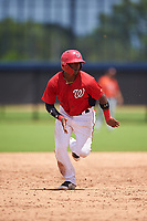 GCL Nationals Leandro Emiliani (10) running the bases during a Gulf Coast League game against the GCL Astros on August 9, 2019 at FITTEAM Ballpark of the Palm Beaches training complex in Palm Beach, Florida.  GCL Nationals defeated the GCL Astros 8-2.  (Mike Janes/Four Seam Images)