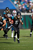 Jacksonville Jaguars quarterback Blake Bortles (5) rushes up field during an NFL Wild-Card football game against the Buffalo Bills, Sunday, January 7, 2018, in Jacksonville, Fla.  (Mike Janes Photography)