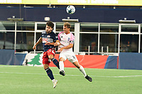 FOXBOROUGH, MA - SEPTEMBER 04: Ryan Spaulding #34 of New England Revolution II and Eli Lockaby #17 Forward Madison FC compete for a high ball during a game between Forward Madison FC and New England Revolution II at Gillette Stadium on September 04, 2020 in Foxborough, Massachusetts.