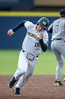 Michigan Wolverines third baseman Jimmy Kerr (15) runs to third base against the Western Michigan Broncos on March 18, 2019 in the NCAA baseball game at Ray Fisher Stadium in Ann Arbor, Michigan. Michigan defeated Western Michigan 12-5. (Andrew Woolley/Four Seam Images)