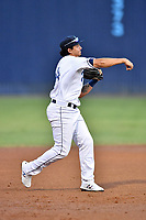 Asheville Tourists third baseman Colton Welker (24) throws to first base during a game against the Greenville Drive at McCormick Field on September 5, 2017 in Asheville, North Carolina. The Tourists defeated the Drive 4-2. (Tony Farlow/Four Seam Images)
