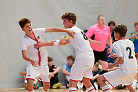 Torhan Kurnaz of Hamilton Boys' High School celebrates with team mates during the Futsal NZ Secondary Schools Junior Boys Final between Hamilton Boys High School and Selwyn College at ASB Sports Centre, Wellington on 26 March 2021.<br /> Copyright photo: Masanori Udagawa /  www.photosport.nz