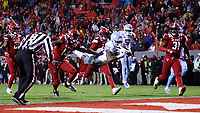 RALEIGH, NC - NOVEMBER 30: Javonte Williams #25 of the University of North Carolina dives into the end zone for a touchdown during a game between North Carolina and North Carolina State at Carter-Finley Stadium on November 30, 2019 in Raleigh, North Carolina.