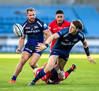 9th September 2020; AJ Bell Stadium, Salford, Lancashire, England; English Premiership Rugby, Sale Sharks versus Sracens; Sam James of Sale Sharks passes the ball after being tackled