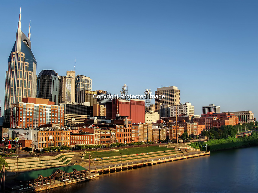Early summer morning in Downtown Nashville, TN. As seen from Shelby Street Bridge going over the Cumberland River.