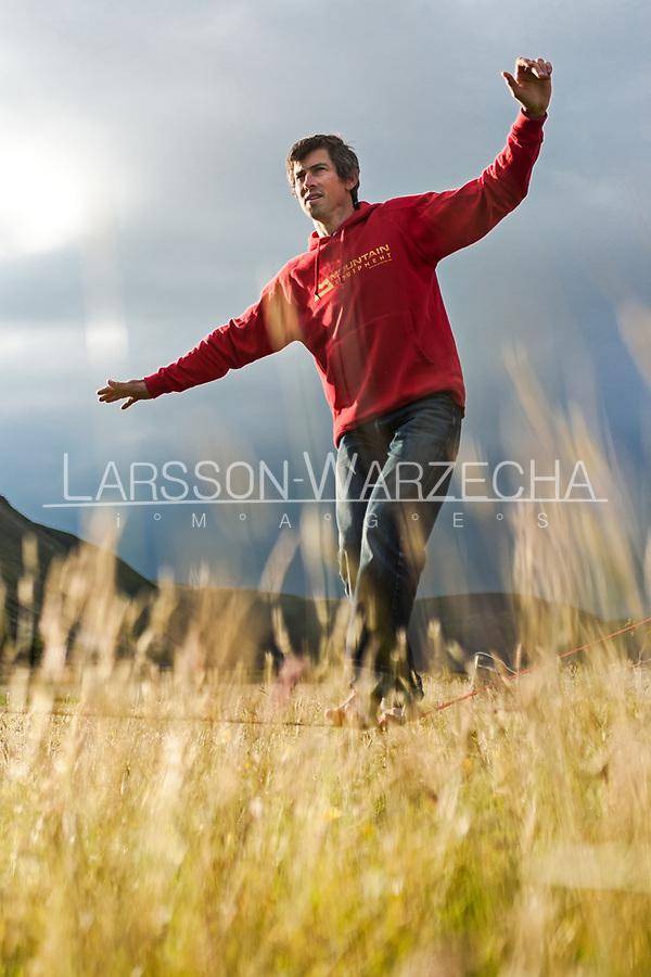 Andy Turner taking a break on a slackline, Hoy, Orkneys, Scotland