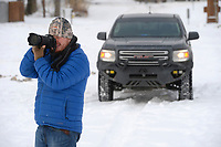Photographer Kolby Morehead of Fayetteville takes pictures Thursday, Feb. 18, 2021, along the West Fork of the White River in Riverside Park in West Fork. Morehead works for Bear Hunting Magazine, which is based in West Fork, and was out taking photographs of the snow and ice along the river. Visit nwaonline.com/210219Daily/ for today's photo gallery. <br /> (NWA Democrat-Gazette/Andy Shupe)