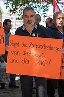 """Kundgebung von Mitgliedern der tuerkischen Partei HDP und Kurden vor dem Auswaertigen Amt in Berlin.<br /> Am Donnerstag den 6. August 2015 protestierten Mitglieder der tuerkischen Partei HDP und Kurden vor dem Auswaertigen Amt in Berlin gegen die fortdauernden Angriffe des tuerkischen Militaers gegen Kurden in der Tuerkei, Syrien und dem Irak.<br /> An der Kundgebung nahemn auch die Bundestagsabgeordnete der Linkspartei, Sevim Dagdelen, der HDP-Abgeordnete aus der kurdischen Stadt Diybakir, Ziya Pir und der Vorsitzende desdeutsch-kurdischen Verein Nav-Dem, Yuksel Koc teil. Die Kundgebungsteilnehmer riefen unter anderem Parolen """"Deutsche Panzer raus aus Kurdistan"""" und Freiheit fuer Rojava - der autonomen kurdischen Region in Syrien.<br /> 6.8.2015, Berlin<br /> Copyright: Christian-Ditsch.de<br /> [Inhaltsveraendernde Manipulation des Fotos nur nach ausdruecklicher Genehmigung des Fotografen. Vereinbarungen ueber Abtretung von Persoenlichkeitsrechten/Model Release der abgebildeten Person/Personen liegen nicht vor. NO MODEL RELEASE! Nur fuer Redaktionelle Zwecke. Don't publish without copyright Christian-Ditsch.de, Veroeffentlichung nur mit Fotografennennung, sowie gegen Honorar, MwSt. und Beleg. Konto: I N G - D i B a, IBAN DE58500105175400192269, BIC INGDDEFFXXX, Kontakt: post@christian-ditsch.de<br /> Bei der Bearbeitung der Dateiinformationen darf die Urheberkennzeichnung in den EXIF- und  IPTC-Daten nicht entfernt werden, diese sind in digitalen Medien nach §95c UrhG rechtlich geschuetzt. Der Urhebervermerk wird gemaess §13 UrhG verlangt.]"""
