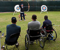 101005-N-7981E-610 SAN DIEGO (October 5, 2010)- Retired Army Cpl. Kevin Stone, a 2004 and 2008 Team U.S.A. Paralympic Gold Medal Winner and current world record holder, teaches archery techniques to service members during the U.S. Olympic Committee's Paralympic Military Sports Camp hosted at Naval Medical Center San Diego. More than 60 injured service men and women from the U.S., British, and Israeli armed forces participated in the four-day event designed to introduce paralympic sport to active duty military personnel and veterans with physical injuries.  (U.S. Navy photo by Mass Communication Specialist 2nd Class James R. Evans / RELEASED)