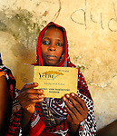 A woman with her savings book at a weekly local meeting of Yehu micro-finance in Kenya.  Yehu is a microfinance organization in the rural coastal region of Kenya for the poor, run by the poor. It provides financial and other support services for small businesses owned by very poor people.