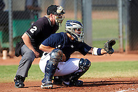 Seattle Mariners minor league catcher Luke Guarnaccia #14 waits for a pitch in front of umpire Brian Devrauwere during an instructional league game against the San Diego Padres at the Peoria Sports Complex on October 6, 2012 in Peoria, Arizona.  (Mike Janes/Four Seam Images)