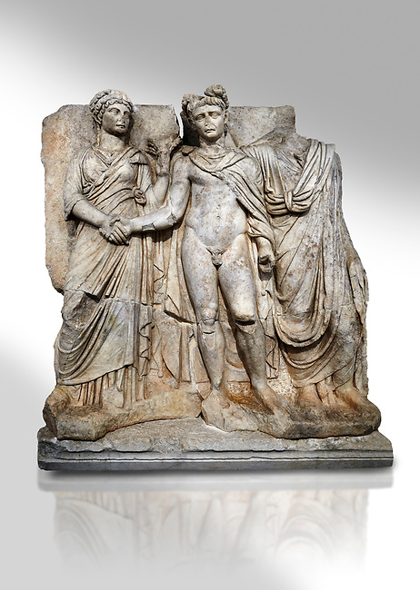"""Roman Sebasteion relief sculpture of emperor Claudius and Agrippina, Aphrodisias Museum, Aphrodisias, Turkey.   Against a white background.<br /> <br /> Claudius in heroic nudity and military cloak shakes hands with his wife Agrippina and is crowned by the Roman people or the Senate wearing a toga. The subject is imperial concord with the traditional Roman state. Agrippina holds ears of wheat: like Demeter goddess of fertility. The emperor is crowned with an oak wreath, the Corona civica or """"citizen crow"""", awarded to Roman leaders for saving citizens lives: the emperor id therefore represented as saviour of the people."""