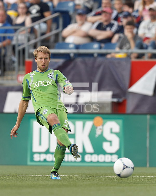 Seattle Sounders FC defender Adam Johansson (5) passes the ball. In a Major League Soccer (MLS) match, the New England Revolution tied the Seattle Sounders FC, 2-2, at Gillette Stadium on June 30, 2012.