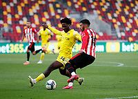 1st October 2020; Brentford Community Stadium, London, England; English Football League Cup, Carabao Cup Football, Brentford FC versus Fulham; Ola Aina  of Fulham tries to block the cross from Said Benrahma of Brentford