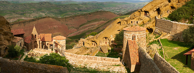 Picture & image of David Gareja Georgian Orthodox monastery, Mount Gareja, Kakheti Region, Georgia (country). 25 km (15 miles) from Gardabani<br /> <br /> Founded in the 6th century by David (St. David Garejeli), one of the  thirteen Assyrian monks who built monasteries throughout Georgia. The 24 plus monasteries of David Gareja are spread out over a huge area of the arid Mount Gareja ridge, with small cells and chapels cut into cliff faces.