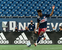 FOXBOROUGH, MA - AUGUST 7: Orlando Sinclair #99 of New England Revolution II passes the ball during a game between Orlando City B and New England Revolution II at Gillette Stadium on August 7, 2020 in Foxborough, Massachusetts.