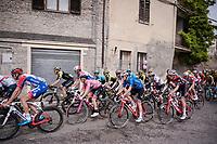 the peloton with Maglia Rosa / overall leader Valerio Conti (ITA/UAE-Emirates) rolling through town<br /> <br /> Stage 8: Tortoreto Lido to Pesaro (239km)<br /> 102nd Giro d'Italia 2019<br /> <br /> ©kramon