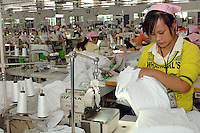 A worker on a production line in a textile factory in the Jiangsu Special Development Zone that makes clothes for western companies including Umbro Sports and New Balance. Much of the world's textile manufacture has moved to China due to relatively low labor rates and high productivity..23 Sep 06