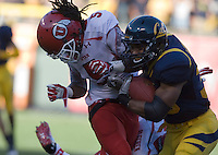 October 22th, 2011:  Covaughn Deboskie-Johnson of California tries to keep rushing while Mo Lee of Utah football tries to stop him during a game at AT&T Park in San Francisco, Ca  -  California defeated Utah  34 - 10