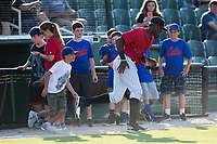 A young baseball player takes the field with Kannapolis Intimidators right fielder Micker Adolfo (27) prior to the game against the Hagerstown Suns at Kannapolis Intimidators Stadium on June 15, 2017 in Kannapolis, North Carolina.  The Intimidators defeated the Suns 9-1 in game two of a double-header.  (Brian Westerholt/Four Seam Images)