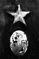 Kazakhstan. Aralsk. Russian graveyard from the time of  former Soviet Union. Picture of a deceased man and the communist red star on the tomb. Aralsk is located in the Kyzyl Orda Province. © 2008 Didier Ruef ... ..