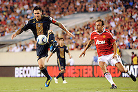 Danny Califf (4) of the Philadelphia Union keeps the ball away from Dimitar Berbatov (9) of Manchester United. Manchester United (EPL) defeated the Philadelphia Union (MLS) 1-0 during an international friendly at Lincoln Financial Field in Philadelphia, PA, on July 21, 2010.