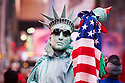 Performer dressed up as The Staue of Liberty who pose for photographs Times Square  Manhattan New York USA