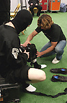 Putting leg & knee braces on for the show.