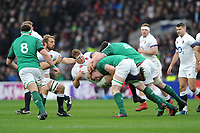 Dylan Hartley (c) of England is knocked backwards during the NatWest 6 Nations match between England and Ireland at Twickenham Stadium on Saturday 17th March 2018 (Photo by Rob Munro/Stewart Communications)