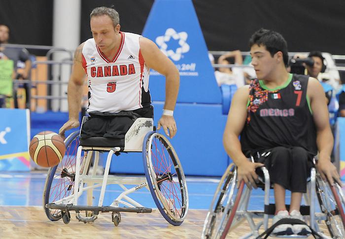 Yvon Rouillard, Guadalajara 2011 - Wheelchair Basketball // Basketball en fauteuil roulant.<br /> Team Canada competes in the bronze medal game // Équipe Canada participe au match pour la médaille de bronze. 11/18/2011.