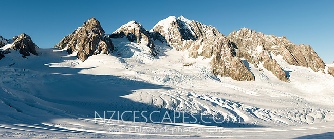Upper Fox Glacier neve with second highest peak of Southern Alps, Mount Tasman 3497m in centre with Mt. Lendenfeld 3194m and Mount Haast 3114m on left and Torres Peak 3160m on right, Westland Tai Poutini National Park, West Coast, UNESCO World Heritage, New Zealand, NZ