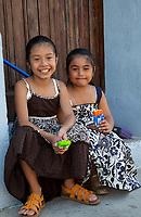 Antigua, Guatemala.  Two Little Girls with their Refreshments.  Semana Santa.