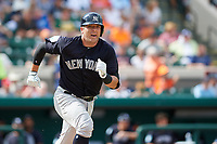 New York Yankees catcher Austin Romine (28) runs to first base during a Grapefruit League Spring Training game against the Detroit Tigers on February 27, 2019 at Publix Field at Joker Marchant Stadium in Lakeland, Florida.  Yankees defeated the Tigers 10-4 as the game was called after the sixth inning due to rain.  (Mike Janes/Four Seam Images)