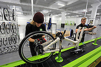 Pictured L-R: Matt Steele and Jack Appleby on the assembly line Monday 15 August 2016<br />Re: Frog Bikes in Mamhilad Estate Park in Pontypool, Wales, UK