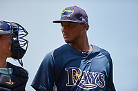 GCL Rays relief pitcher Angel Felipe (35) walks off the field with catcher Dawson Dimon (44) during a game against the GCL Red Sox on August 1, 2018 at JetBlue Park in Fort Myers, Florida.  GCL Red Sox defeated GCL Rays 5-1 in a rain shortened game.  (Mike Janes/Four Seam Images)