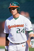 Yasmani Grandal #24 of the Miami Hurricanes looks to the dugout for the sign as he bats against the Florida State Seminoles at the 2010 ACC Baseball Tournament at NewBridge Bank Park May 26, 2010, in Greensboro, North Carolina.  The Hurricanes defeated the Seminoles 9-3.  Photo by Brian Westerholt / Four Seam Images