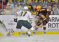 24 November 2012: University of Minnesota Golden Gopher forward Christian Isackson, a Sophomore from Pine City, MN, in action against the University of Vermont Catamounts at Gutterson Fieldhouse in Burlington, Vermont. The Gophers defeated the Catamounts 3-1 in the second game of their 2-game non-divisional weekend series. Mandatory Credit: Ed Wolfstein Photo