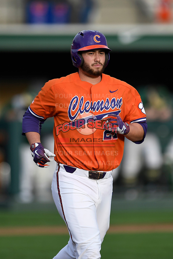 First baseman Chris Williams (27) of the Clemson Tigers runs out a batted ball in a game against the William and Mary Tribe on February 16, 2018, at Doug Kingsmore Stadium in Clemson, South Carolina. Clemson won, 5-4 in 10 innings. (Tom Priddy/Four Seam Images)