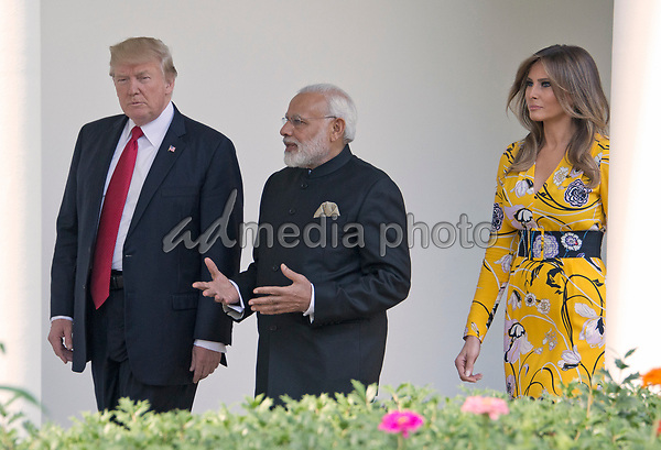 United States President Donald J. Trump and first lady Melania Trump walk on the Colonnade to the Oval Office with Prime Minister Narendra Modi of India at the White House in Washington, DC on Monday, June 26, 2017. Photo Credit: Ron Sachs/CNP/AdMedia