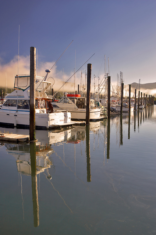 Boats and fog in harbor in Garabali. Oregon