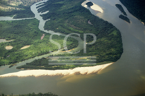 Araguaia River, Amazon, Brazil. Aerial view; river, tributary with islets and sediment deposition on inside of bends.