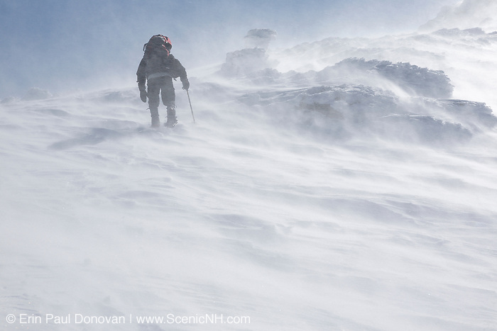 A winter hiker ascending the Air Line Trail in extreme weather conditions in the White Mountains, New Hampshire during the winter months.