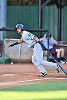 Pulaski Yankees center fielder Pablo Olivares (14) swings at a pitch during a game against the Elizabethton Twins at Joe O'Brien Field on June 27, 2016 in Elizabethton, Tennessee. The Yankees defeated the Twins 6-4. (Tony Farlow/Four Seam Images)